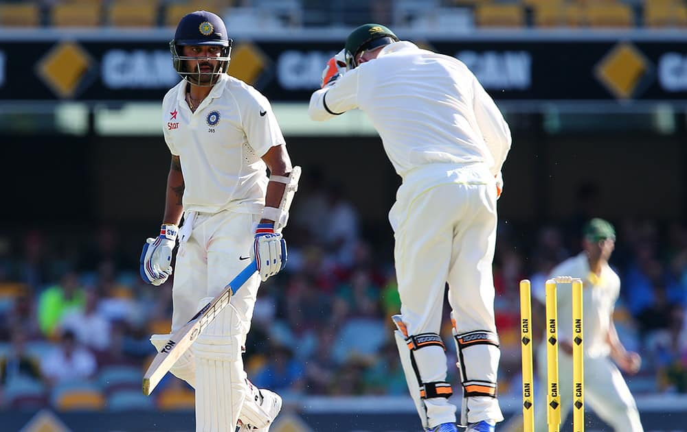 Murali Vijay, looks back to see he is out stumped by Australian wicketkeeper Brad Haddin during play on day one of the second cricket test in Brisbane, Australia.
