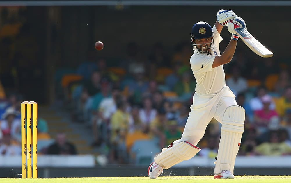 Ajinkya Rahane plays a shot during play on day one of the second cricket test against Australia in Brisbane.