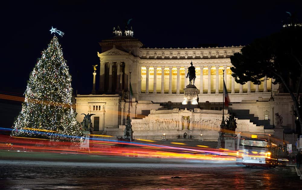 A bus passes by a Christmas tree that was set up in front of the Unknown Soldier Monument, in Rome.