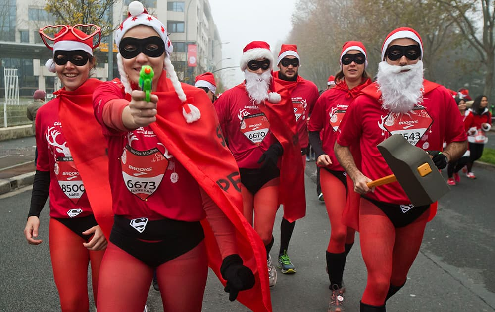 Runners, dressed as Santa Claus, take part in the 38th