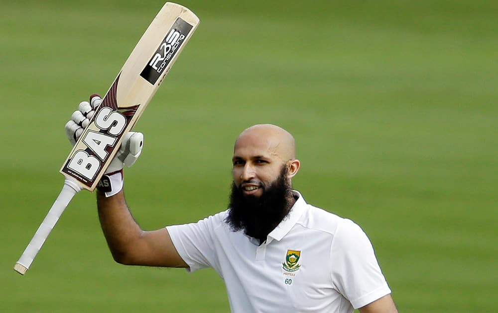 South Africa's captain Hashim Amla, celebrates his century on the first day of their 1st cricket Test match against West Indies at Centurion Park in Pretoria, South Africa.