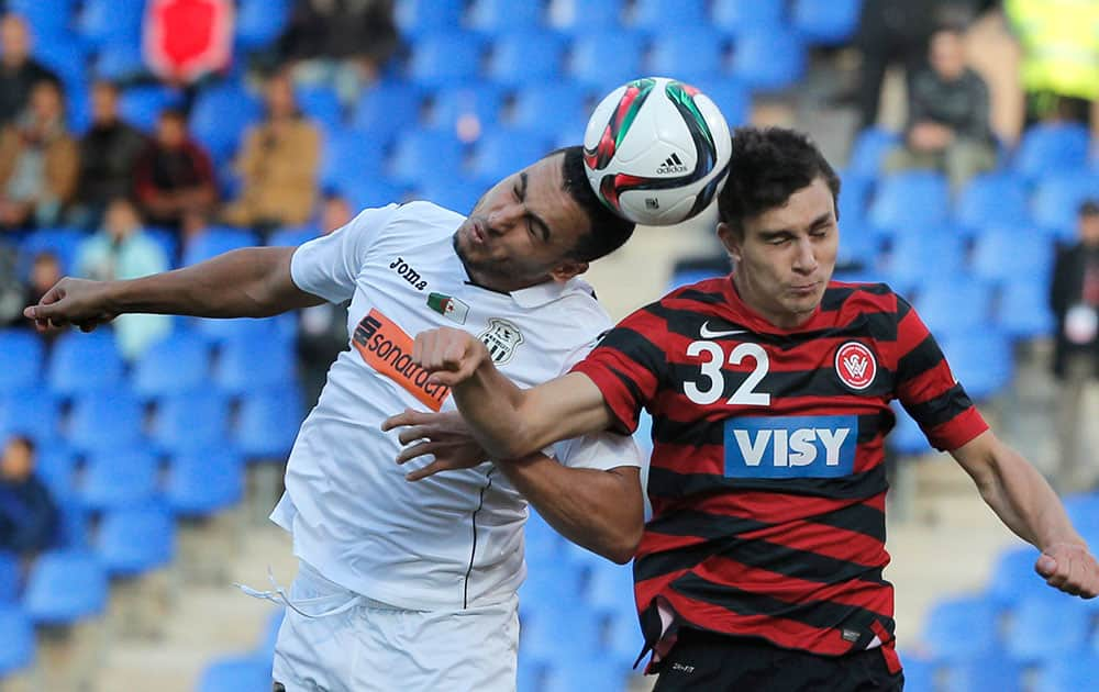 Western Sydney Wanderers' Daniel Alessi, right, and ES Setif's Mohamed Benyettou jump for the ball during the 5th place soccer match between ES Setif and Western Sydney Wanderers at the Club World Cup soccer tournament in Marrakech, Morocco.