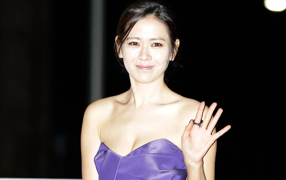 South Korean actress Son Ye-jin waves for the media during a red carpet event for Blue Dragon Film Awards in Seoul, South Korea.