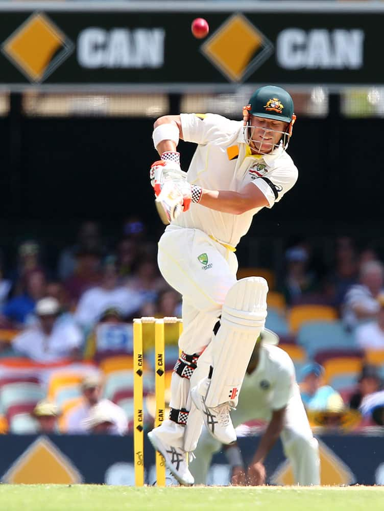 Australia's David Warner plays out a ball to be out caught for 29 runs during play on day two of the second cricket test in Brisbane, Australia.