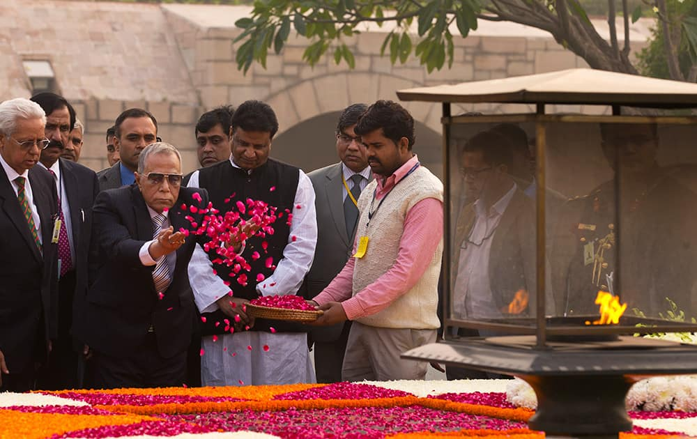 Bangladesh's President Abdul Hamid throws flowers as he pays respect at Rajghat, the memorial to the late Mahatma Gandhi in New Delhi.