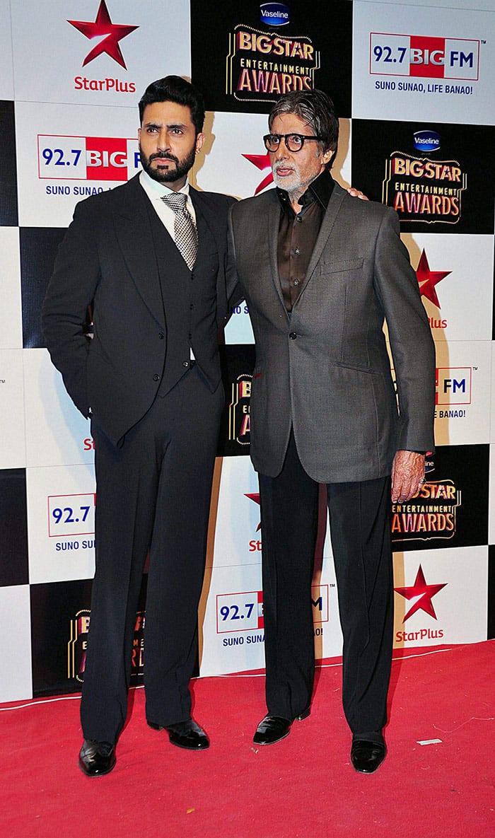 Amitabh Bachchan and Abhishek Bachchan at an Awards function in Mumbai.