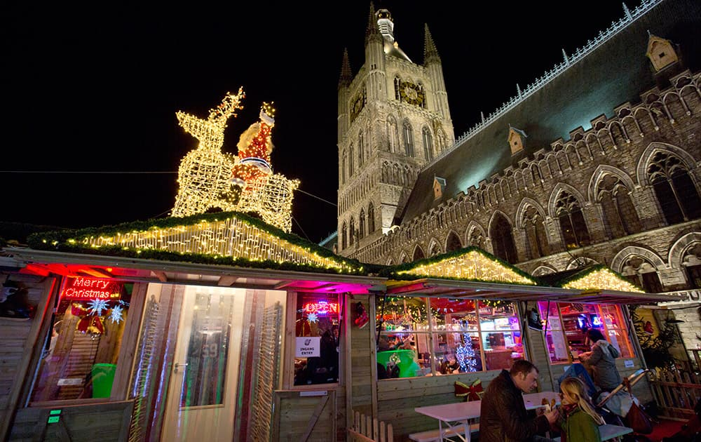 People spend time at a Christmas market in the town square of Ypres, Belgium.