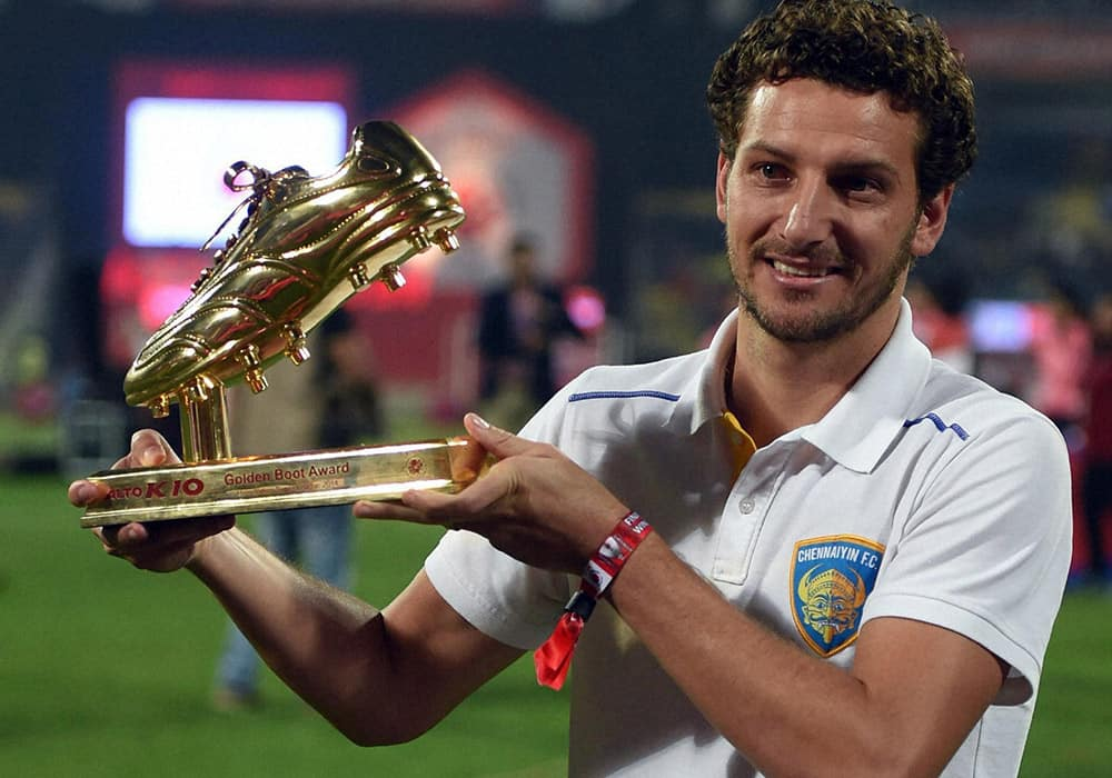 Chennayin FC player Elano Blumer poses to the media after receiving the Golden Boot award during the Indian Super League final match in Navi Mumbai.