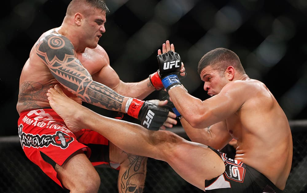 Daniel Serafian from Brazil, fights Antonio dos Santos, also from Brazil, during their middleweight mixed martial arts bout at UFC in Barueri, on the outskirts of Sao Paulo, Brazil.