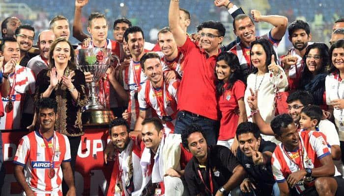Former Indian cricket captain and co-owner of ISL franchise Atletico de Kolkata Sourav Ganguly and his team pose for a picture as they celebrate after winning the Indian Super League final match against Kerala Blaster FC in Navi Mumbai on Saturday. ISL founding chairperson Nita Ambani is also seen.