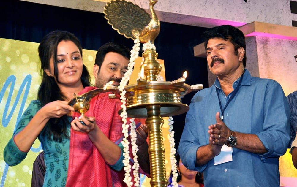 Actress Manju Variyar lights the inaugural lamp during the FEFKA Cinema Still Photographers union meeting in Kochi.