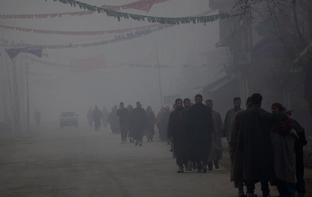 Kashmiris walk towards a polling station to cast their votes on a cold and foggy morning in Kulangham, some 68 kilometers north of Srinagar.