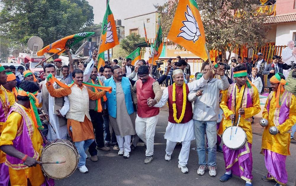 BJP Party workers celebrate after Jharkhand Assembly Election results declared , at state party office, Harmu in Ranchi.