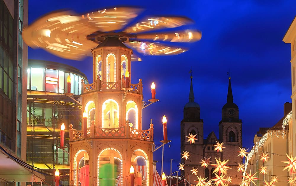 Christmas pyramid spins at the Christmas market in Magdeburg, Germany.