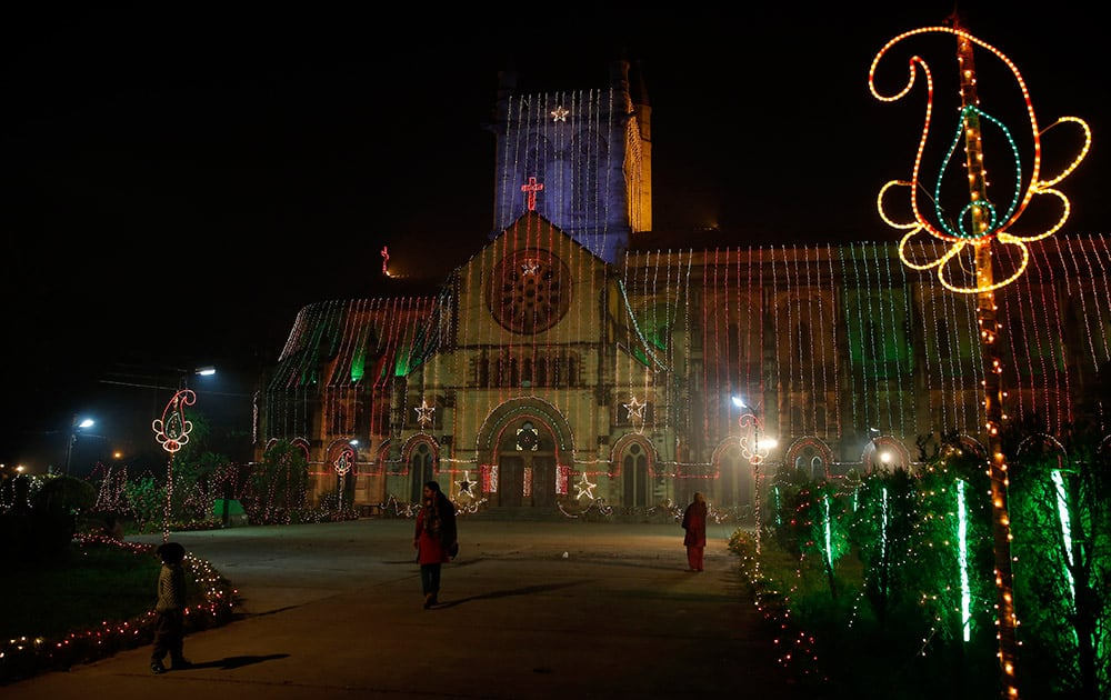 People visit the All Saints Cathedral, illuminated to mark Christmas, in Allahabad.