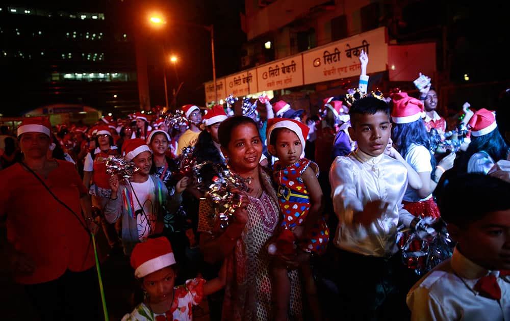 People walk in a Christmas carnival in Mumbai.