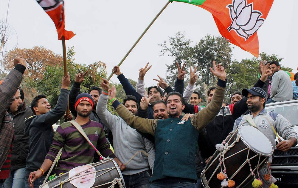 BJP party workers celebrate after J&K results at Polytechnic college in Jammu.
