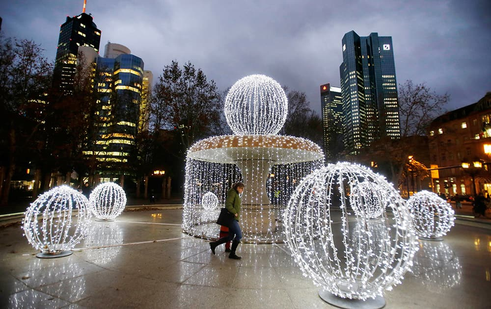 Strings of lights are fixed at the fountain in front of the ban towers in Frankfurt, Germany.
