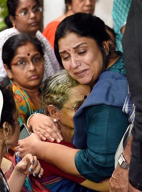 Director K Balachanders wife Sulakshana, is consoled by actress Sripriya after pay her last respects at the funeral of Dadasaheb Phalke Award winner and veteran film director K Balachander, at his residence in Chennai.