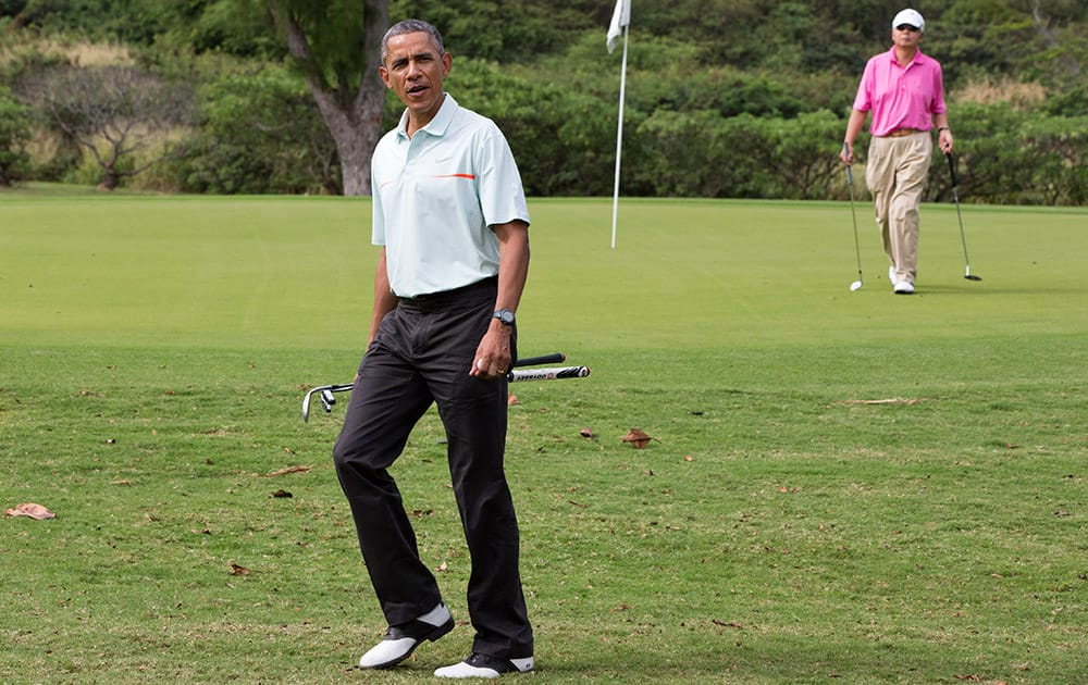 President Barack Obama plays golf with Malaysian Prime Minister Najib Razak, at Marine Corps Base Hawaii's Kaneohe Klipper Golf Course in Kaneohe, Hawaii during the Obama family vacation.