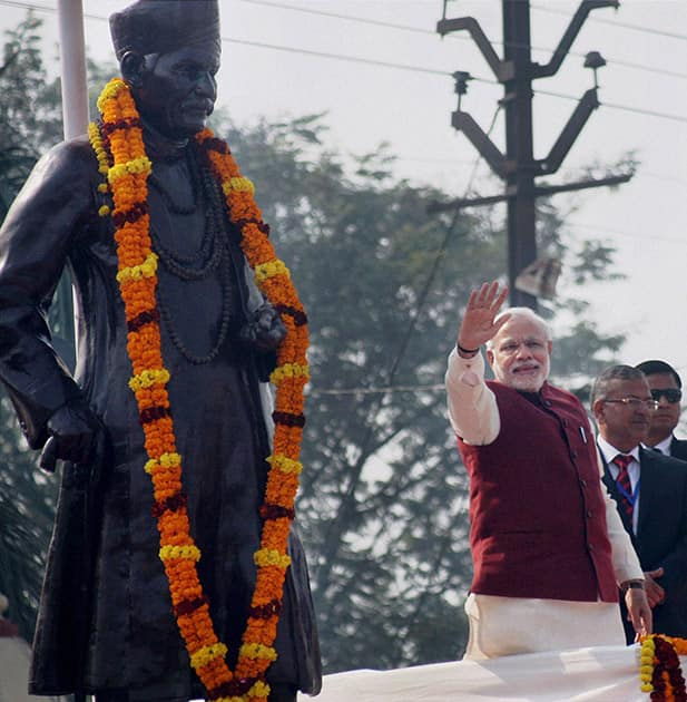 Prime Minister Narendra Modi waves after paying floral tribute to the statue of Madan Mohan Malaviya.