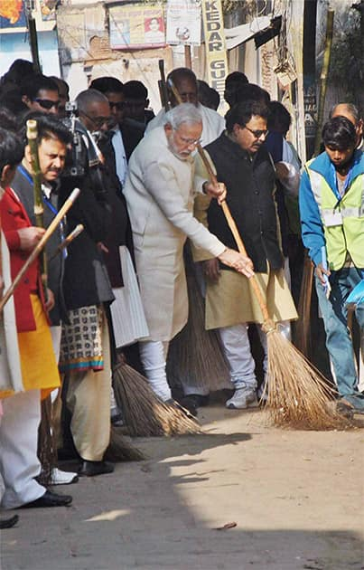 Prime Minister Narendra Modi during a cleanliness drive at Assi Ghat as part of Swachh Bharat Campaign, in Varanasi.