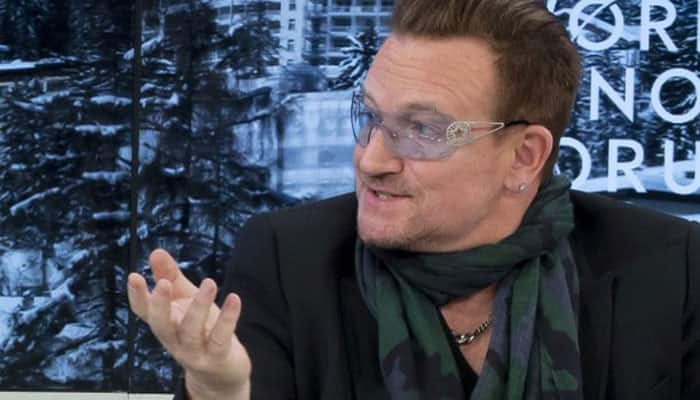 Bono spotted with armcast post accident