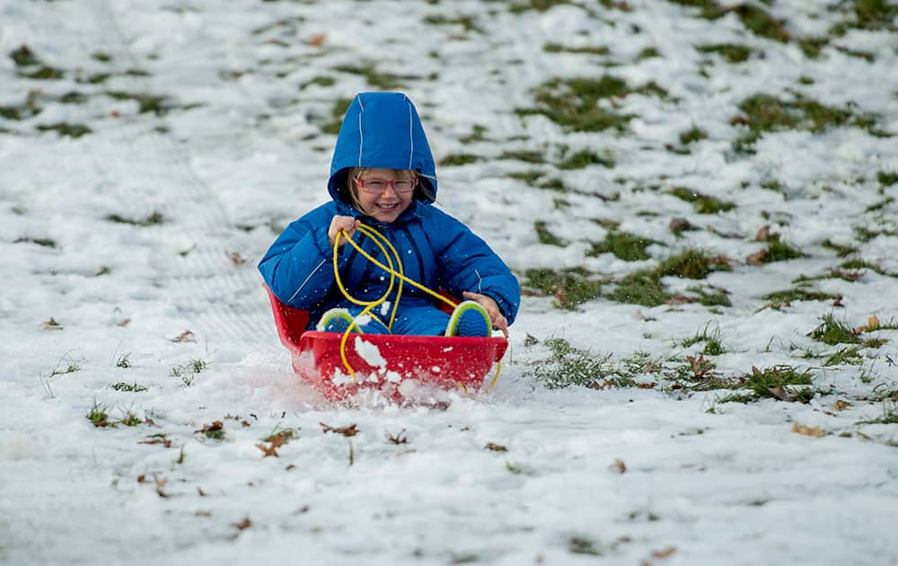 Matilda Green, 4, rides a sled in the Arboretum on Christmas in Ottawa, Ontario.