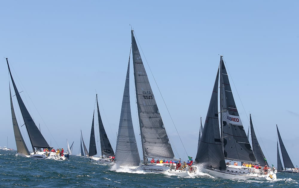 Competitors from mid-fleet make their way out Sydney Harbour during the start of the Sydney Hobart yacht race in Sydney.