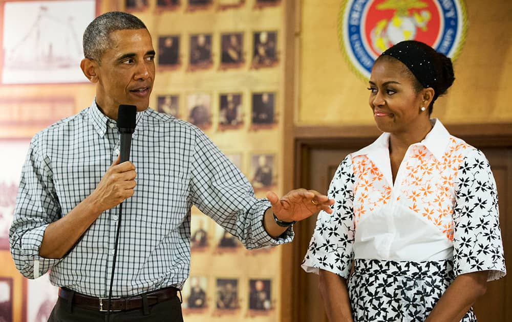 President Barack Obama, with first lady Michelle Obama, greets troops and their families on Christmas Day, at Marine Corps Base Hawaii in Kaneohe Bay, Hawaii during the Obama family vacation.