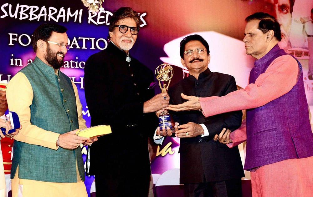 Bollywood actor Amitabh Bachchan receives the second Yash Chopra Memorial Award from Maharashtra Governor C Vidyasagar Rao in Mumbai. Also seen filmmaker T Subbarami Reddy and Prakash Javadekar, Union Minister for Environment and Information & Broadcasting.