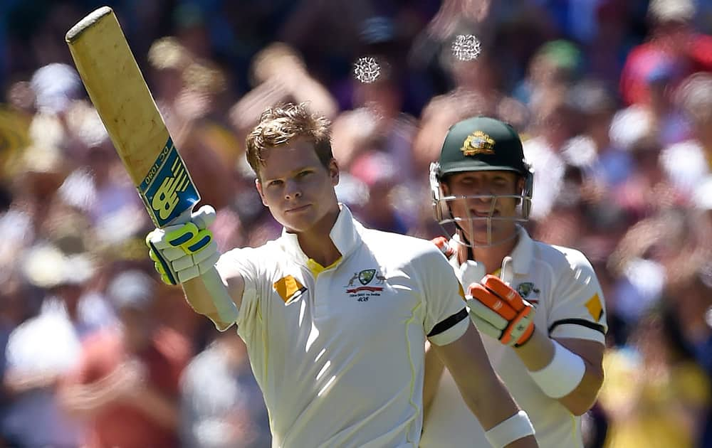 Australia's captain Steve Smith, celebrates after making 100 runs against India during the second day of their cricket test match in Melbourne, Australia.
