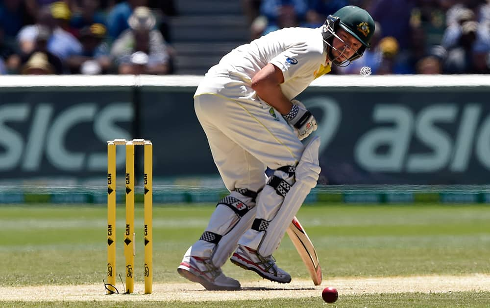 Australia's Ryan Harris doubles over after he was struck by a delivery from India on the second day of their cricket test match in Melbourne, Australia.