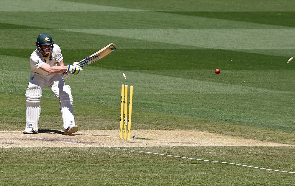 Steve Smith is bowled for 192 runs against India on the second day of their cricket test match in Melbourne, Australia.