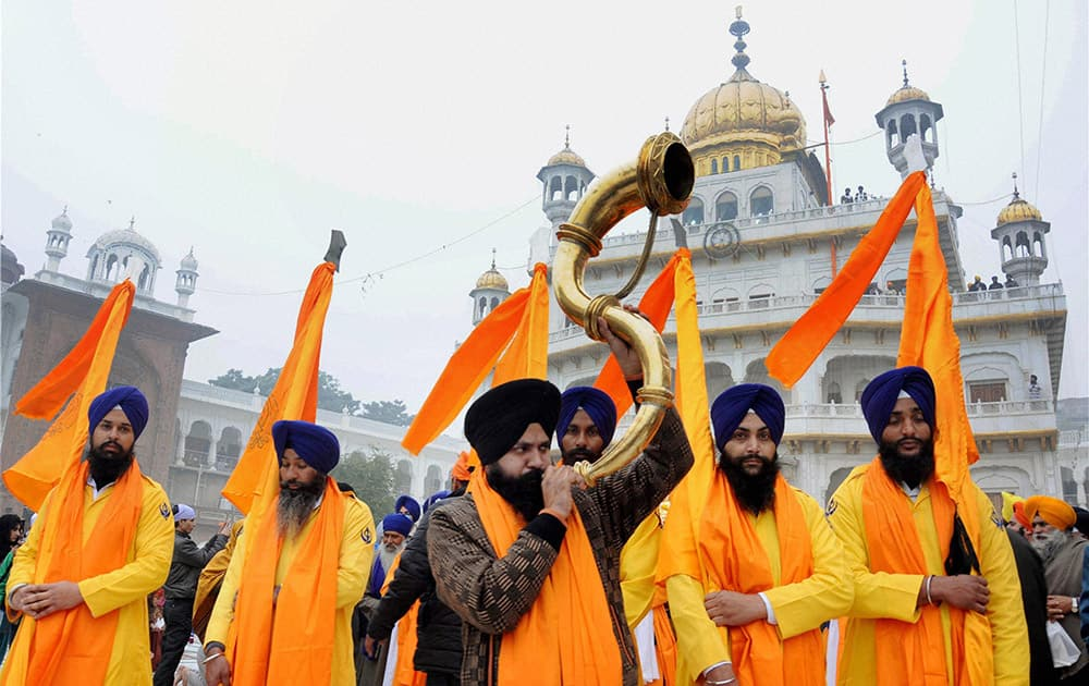 Panj Pyare members during a religious procession at the Golden Temple on the eve of birth anniversary of Guru Gobind Singh, in Amritsar.