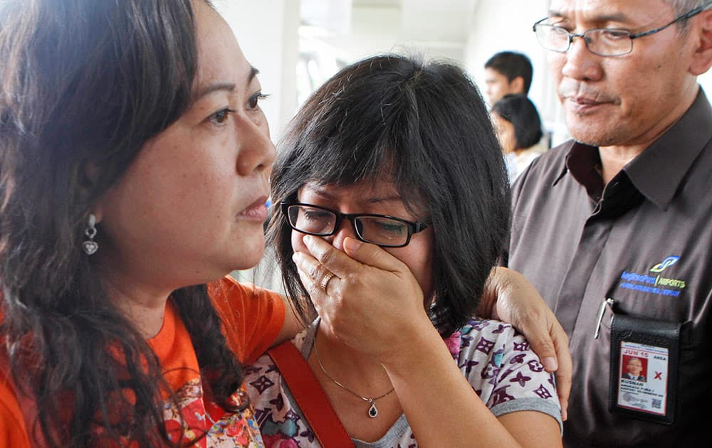 A relative of Air Asia flight QZ8501 passengers weep as she waits for the latest news on the missing jetliner at Juanda International Airport in Surabaya, East Java, Indonesia.