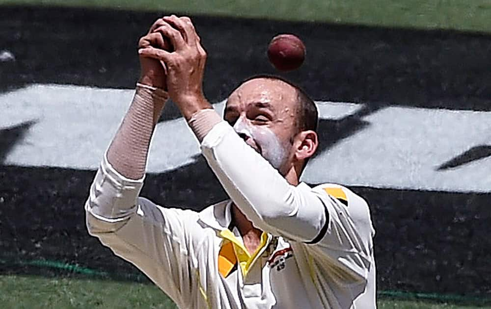 Australia's Nathan Lyon can not catch the ball hit by India's Ajinkya Rahane on the third day of their cricket test match in Melbourne, Australia.