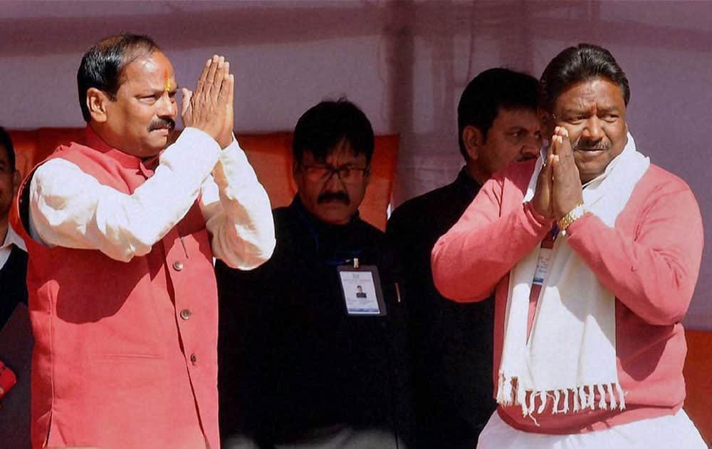 Jharkhand Chief Minister Raghubar Das with Minister Nilkath Singh Munda after the swearing in ceremony in Ranchi.