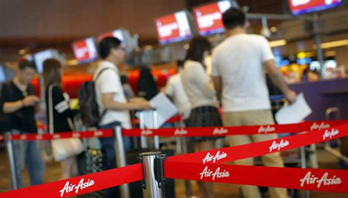 AirAsia Flight QZ8501 en route from Indonesia to Singapore with 162 people goes missing