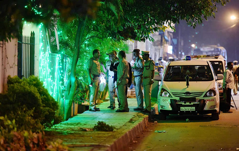 Police officials on spot where a low intensity bomb blast occurred at church street in Bengaluru.