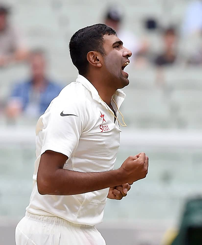 India's Ravichandran Ashwin celebrates trapping Australia's David Warner LBW for 40 runs on the fourth day of their cricket test match in Melbourne, Australia.