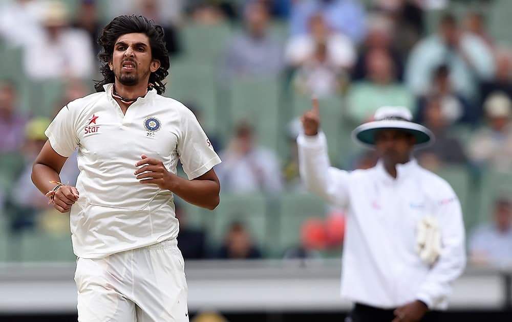Ishant Sharma follows through on his delivery after taking the wicket of Australia's Joe Burns for 9 runs during the fourth day of their cricket test match in Melbourne, Australia.