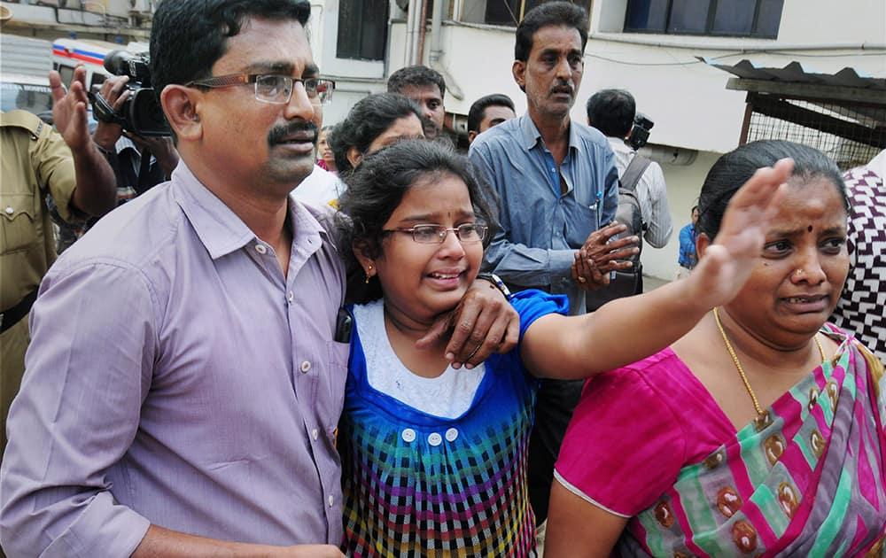 Family members of Bhawani Bala, the deceased in the Bengaluru blast, mourn outside a hospital in Bengaluru.