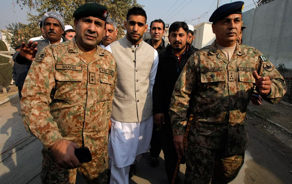 British boxer Amir Khan, who is of Pakistani origin, arrives at a military-run public school attacked by Taliban, in Peshawar.