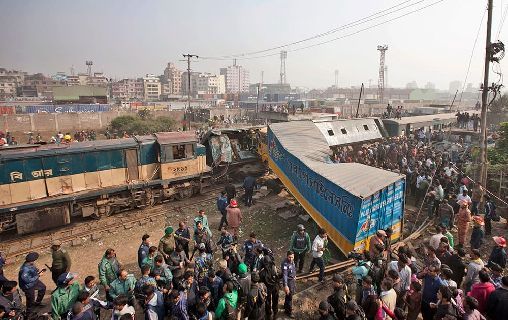 Bangladeshi people gather after a lorry rammed into a passenger train in Dhaka, Bangladesh. Several persons were killed and more than 20 others were injured in the accident, according to local reports.