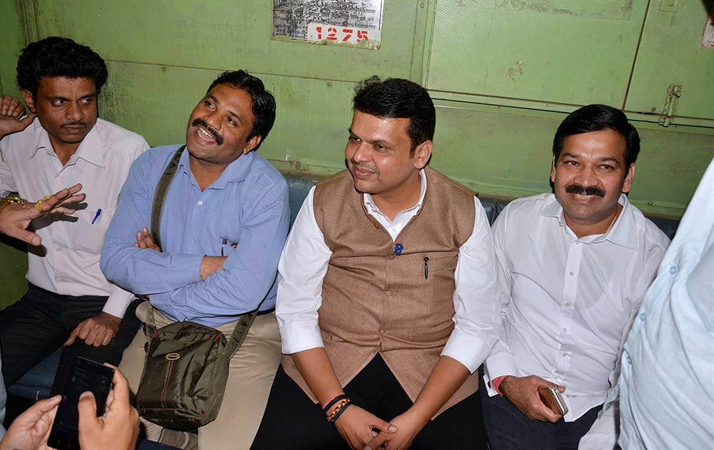 Maharashtra Chief Minister Devendra Fadnavis interacts with commuters while traveling on a suburban train from Chhatrapati Shivaji Terminus (CST) to Kalyan.