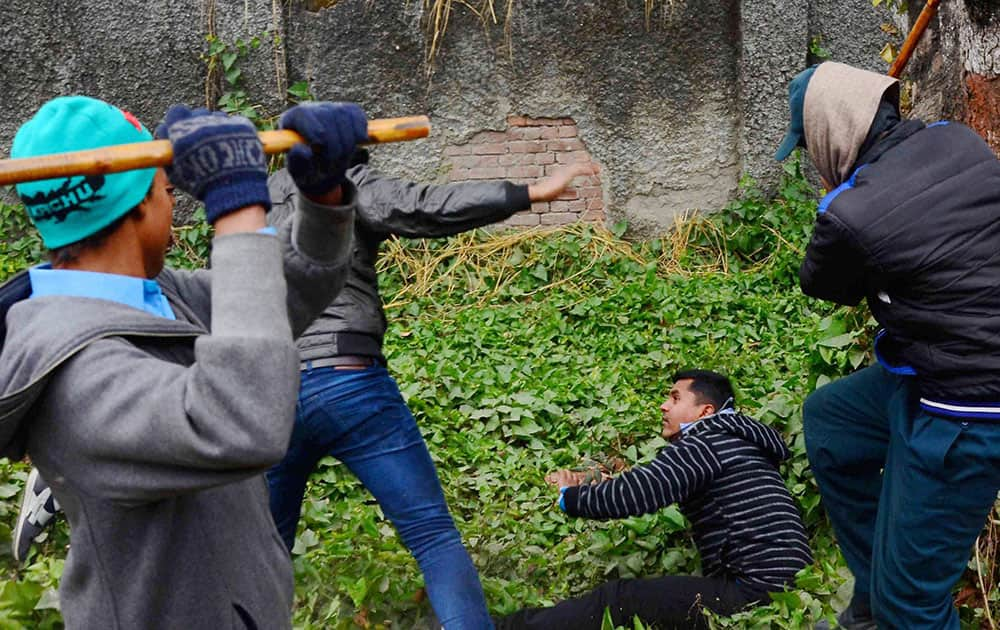 Security guards of Sam Higginbottom Institute of Agriculture Technology and Sciences beat ABVP activists who were protesting against Vice Chancellor, R B Lal, in Allahabad.