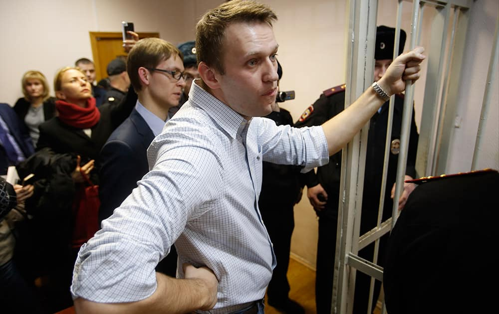 Russian opposition activist and anti-corruption crusader Alexei Navalny, 38, stands at a court in Moscow, Russia. Alexei Navalny, the anti-corruption campaigner who is a leading foe of Russian President Vladimir Putin, has been found guilty of fraud and given a suspended sentence of three and a half years.