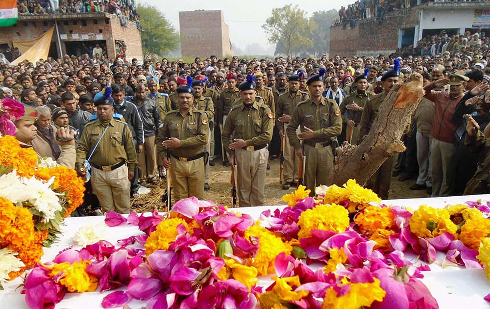 CRPF soldiers offer guard of honour to their fallen comrade Chandra Mani Yadav who died at Chhattisgarh in a Naxal attack, at Charwa in Kaushambi district of Uttar Pradesh.