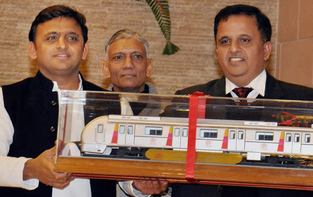 Uttar Pradesh Chief Minister Akhilesh Yadav unveiling the models of coaches to be used for the Lucknow Metro, at his residence in Lucknow.